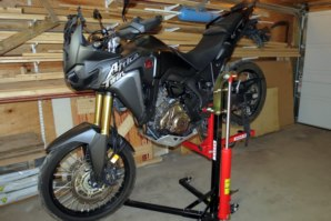 Honda CFR1000L on abba Sky Lift in stoppie position