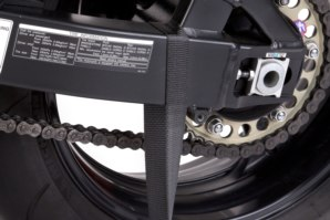 Strap attached around swing arm.
