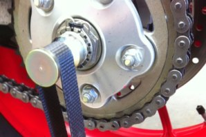 Lifting strap fitted around Hub Spindle (single sided swing arm bikes)